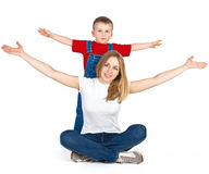 Mother and son spreading out their arms Stock Images