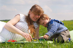 Mother and son in spring meadow Royalty Free Stock Photography