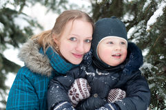 Mother and son in  spruce forest Stock Photography