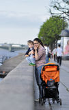 Mother and son stand on the embankment in Sankt Petersburg Royalty Free Stock Photo