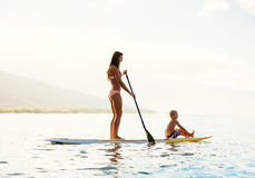 Mother and Son Stand Up Paddling Together Stock Photos