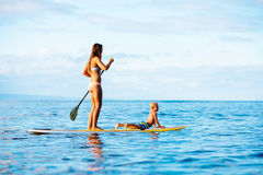 Mother and Son Stand Up Paddling Together Royalty Free Stock Images