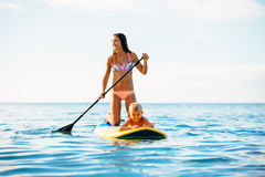Mother and Son Stand Up Paddling Together Stock Photo