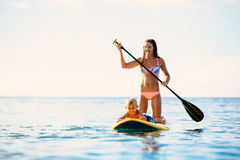 Mother and Son Stand Up Paddling Together Stock Image