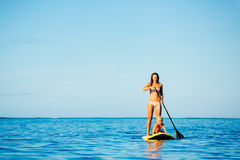 Mother and Son Stand Up Paddling Together Royalty Free Stock Photo