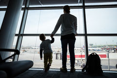 Mother and son standing near window in airport Royalty Free Stock Photography