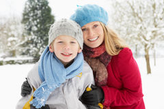 Mother And Son Standing Outside In Snowy Landscape Stock Images
