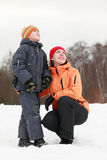 Mother and son standing at snow Royalty Free Stock Images