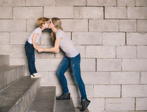 Mother and son standing on a stairs. And kissing Stock Images