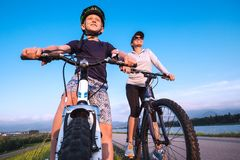 Mother and son starting ride a bicykle Royalty Free Stock Photos