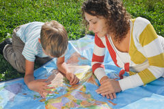 Mother and son studies political map of world Stock Photo