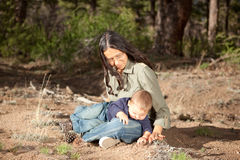 Mother and son studying things in nature. Mother and baby boy studying things in nature Stock Image