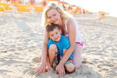 Mother with son at summer holiday on beach Stock Photos