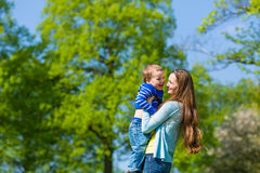 Mother and son on a summer meadow Royalty Free Stock Image