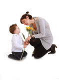 Mother and son  with sunflowers Royalty Free Stock Photography