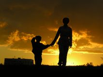 Mother with son sunset Royalty Free Stock Image