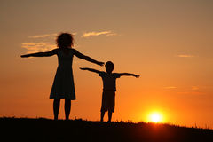 Mother and son on sunset stretching Stock Images