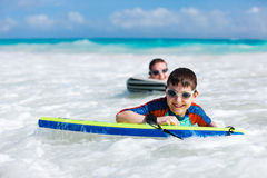 Mother and son surfing Royalty Free Stock Photography
