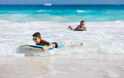 Mother and son surfing Royalty Free Stock Image