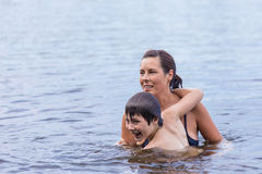 Mother and son swimming in lake Royalty Free Stock Images