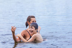 Mother and son swimming in the lake Royalty Free Stock Photos