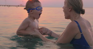 Mother and Son Swimming in the Sea Together stock video footage