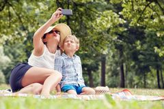 Mother with son take a selfie photo Stock Images
