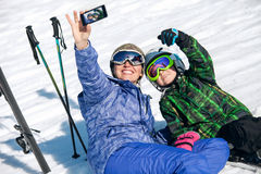 Mother and son take a selfie photo on ski resort Stock Photos