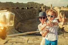 Mother with son take a vacation photo on the Side ampitheatre vi. Ew Royalty Free Stock Image