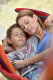 Mother and son taking nap in hammock Stock Photography