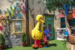 Mother and son taking photo with Big Bird on Sesame Street at Seaworld 77.
