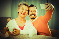 Mother and son taking photos Royalty Free Stock Image
