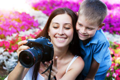 Mother and son are taking pictures in the flower Royalty Free Stock Photography