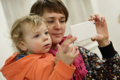 Mother with son taking selfie Royalty Free Stock Images
