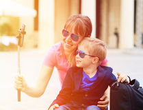 Mother and son taking selfie stick picture while Royalty Free Stock Image