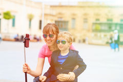 Mother and son taking selfie stick picture while Stock Photos