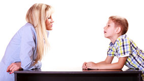 Mother and son talk and argue sit at table. Relationships arguments and discussion. Mother and son sit at table and argue discuss solve problem Royalty Free Stock Photos