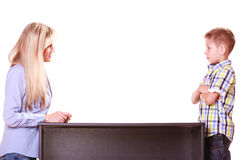 Mother and son talk and argue sit at table. Royalty Free Stock Image
