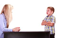 Mother and son talk and argue sit at table. Relationships arguments and discussion. Mother and son sit at table and argue discuss solve problem Stock Photos