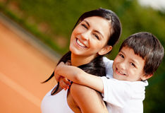 Mother and son at the tennis court Stock Photo