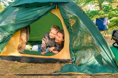 Mother and son in a tent Royalty Free Stock Photography