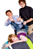 Mother and son are tickling the boy Royalty Free Stock Images