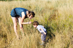 Mother with a son on to the meadow Stock Photography