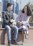 Mother and son are together. Couple sitting on a banch in the park stock photos