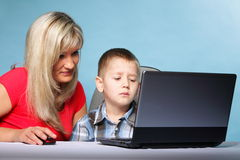 Mother with son looking on the laptop Royalty Free Stock Images