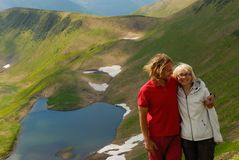Mother and son together in the mountains in the summer. Green sl Royalty Free Stock Image