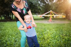 Mother and son together outside Stock Photos