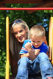 Mother and son together at the playground Stock Photos