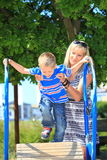 Mother and son together at the playground Stock Photography