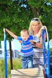 Mother and son together at the playground Stock Images